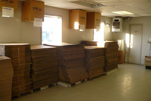 Stacks of flattened corrugated boxes available at Leduc Bottle Depot for moving, for storage, for anything!